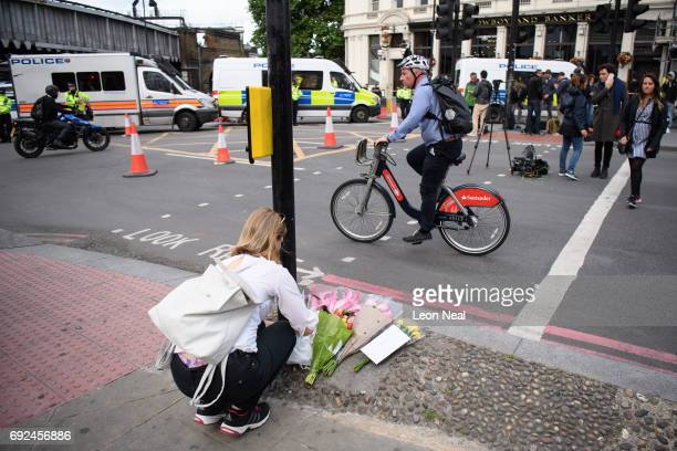 A woman lays flowers on London Bridge after it was reopened following the June 3rd terror attack on June 5 2017 in London England Seven people were...