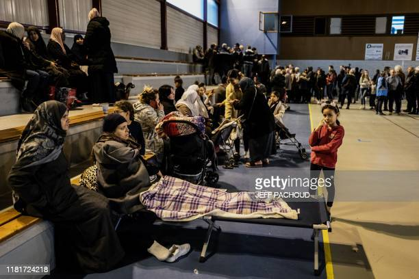 A woman lays in a cot as people gather in a gymnasium in Le Teil southeastern France on November 11 after an earthquake with a magnitude of 54 hit...