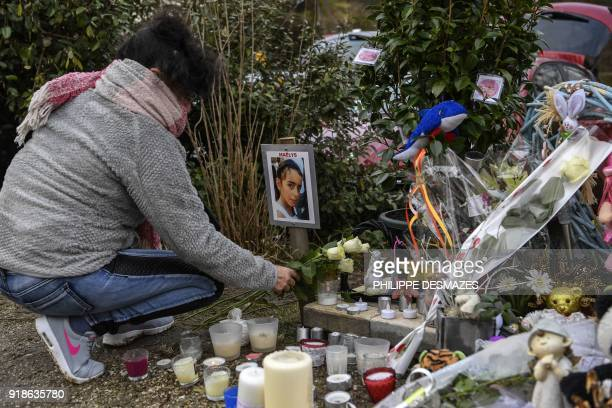 A woman lays roses at a makeshift memorial in tribute to eightyearold Maelys de Araujo on February 15 2018 in Le PontdeBeauvoisin near Chambery at...
