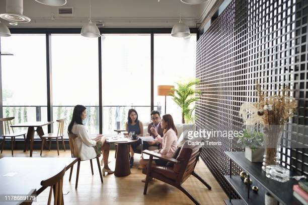 Woman leading a meeting in a co-working office