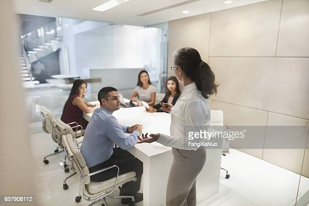 Woman leading business presentation in conference room