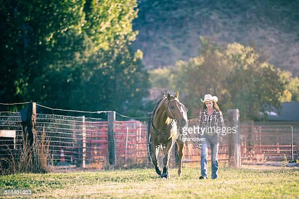 Woman Leading Horse