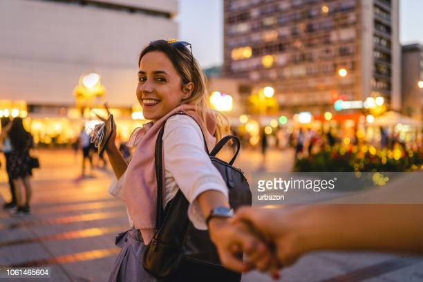 woman leading man by the hand - following moving activity stock pictures, royalty-free photos & images