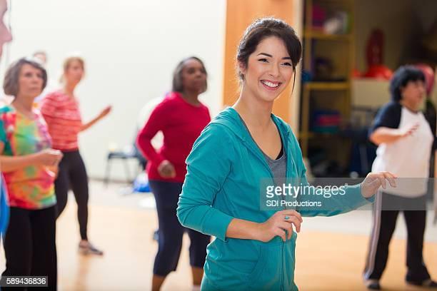 Woman leads dance class at senior center