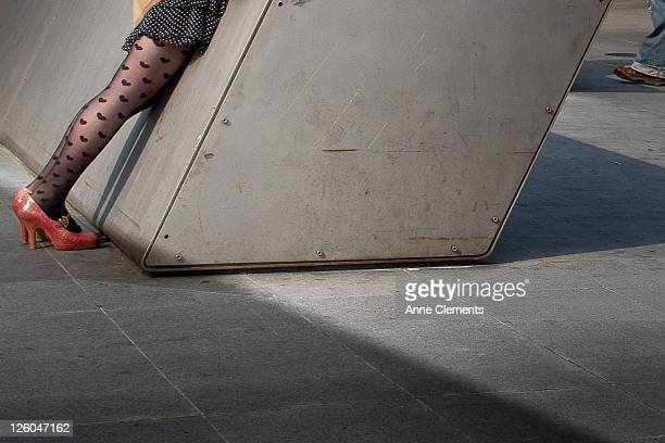 Woman leaning against steel structure