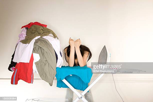 Woman Leaning down on ironing borad