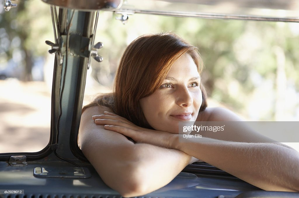 Woman Leaning in a Car Window : Stock Photo