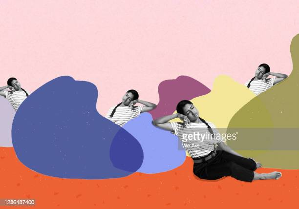 woman leaning on beanbags - sleeping stock pictures, royalty-free photos & images