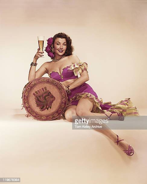 Woman leaning on cushion and holding beer glass