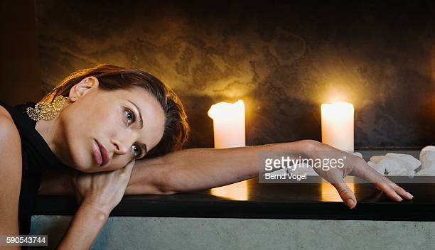 Woman leaning on fireplace
