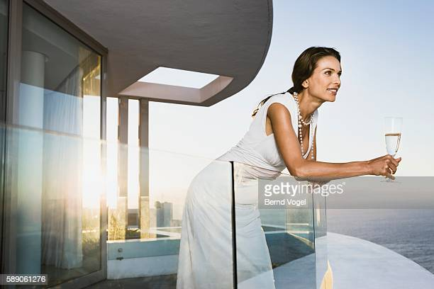 Woman leaning on glass railing