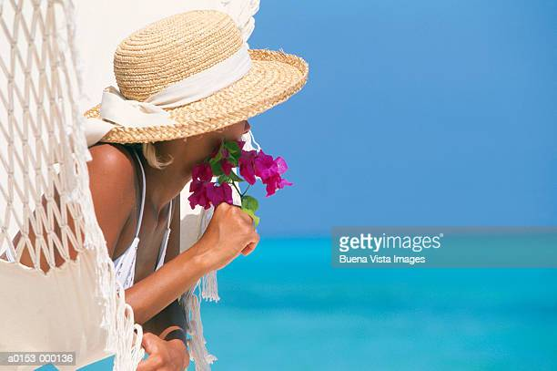 woman leaning on hammock - straw hat stock pictures, royalty-free photos & images