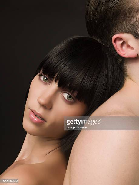 Woman leaning on male back