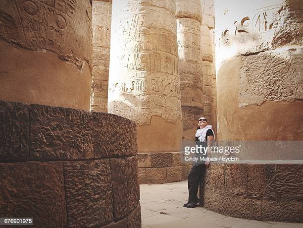 Woman Leaning On Pillar At Temples Of Karnak