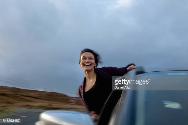 Woman leaning out of car window, Connemara, Ireland