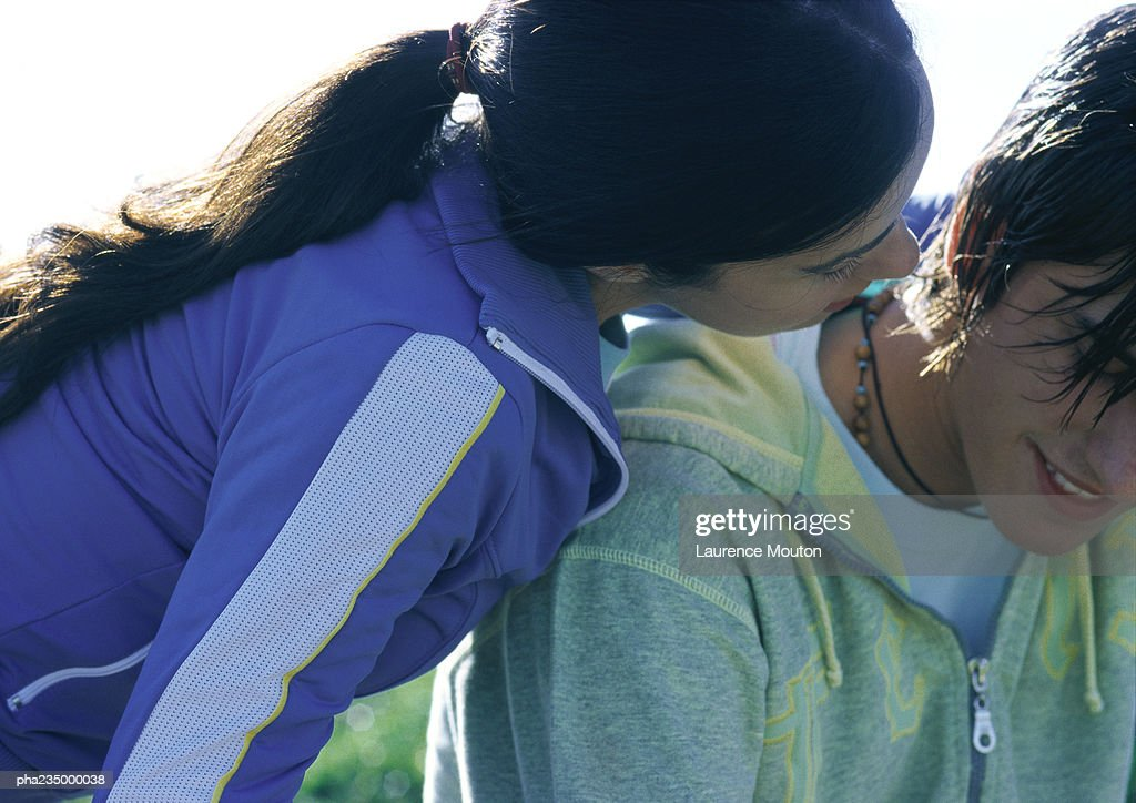 Woman leaning over man, close up. : Stockfoto
