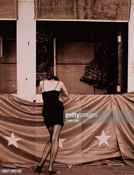 woman leans over banner - seamed stockings stock pictures, royalty-free photos & images