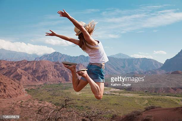 woman leaping in mid-air