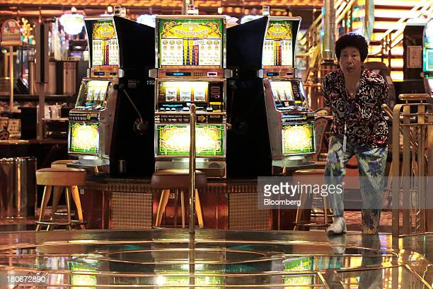 A woman leaves a casino aboard the Royal Caribbean Cruises Ltd's Voyager of the Seas berthed at the Ohi wharf in Tokyo Japan on Saturday Sept 14 2013...