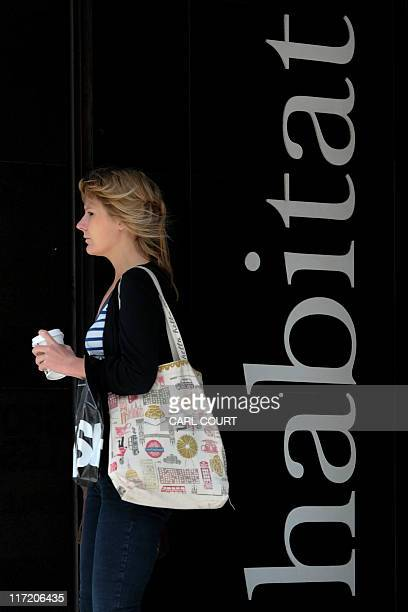 A woman leaves a Habitat store in central London on June 24 2011 Britain's Home Retail Group on Friday said it had bought the Habitat UK brand and...