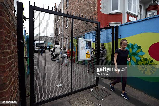 A woman leaves a Kids Company premises on August 5 2015 in Camberwell London England Kids Company a charity for vulnerable youngsters headed by chief...