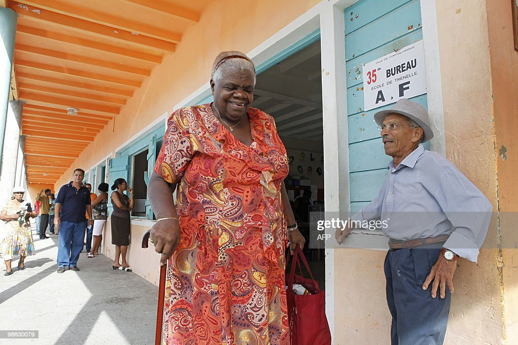 A woman leaves a polling station after voting, on March 21, 2010, in Fort de France, in the French Caribbean island of Martinique, during the second round of the French regional elections. French voters came out today expected to deal French President a stinging rebuke in regional elections that will be his last big national test before seeking re-election in 2012.