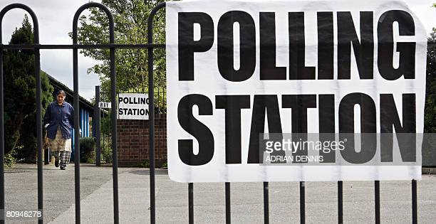 A woman leaves a polling station during the local elections at Wellington Day Centre in Hounslow west of London on May 1 2008 Voters went to the...