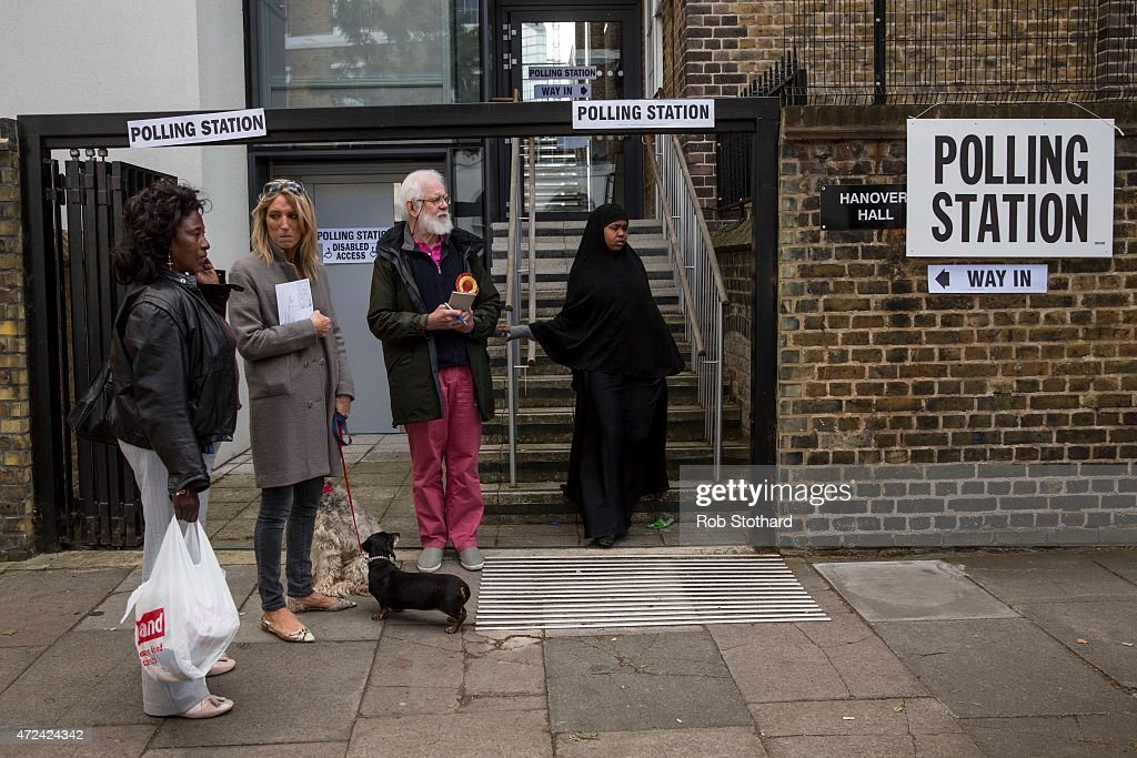 A woman leaves a polling station in the Borough of Islington on May 7, 2015 in London, United Kingdom. The United Kingdom has gone to the polls to vote for a new government in one of the most closely fought General Elections in recent history. With the result too close to call it is anticipated that there will be no overall clear majority winner and a coalition government will have to be formed once again.