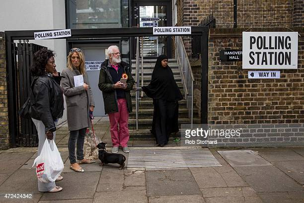 A woman leaves a polling station in the Borough of Islington on May 7 2015 in London United Kingdom The United Kingdom has gone to the polls to vote...