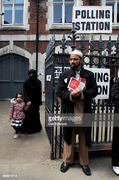 A woman leaves a polling station on Brick Lane after casting her vote on May 6 2010 in London United Kingdom After 5 weeks of campaigning including...