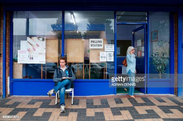 A woman leaves a Polling Station set up in a launderette and nail bar in Headington outside Oxford west of London on June 8 as Britain holds a...