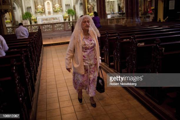 Woman leaves a Sunday afternoon Catholic mass October 17, 2010 at the Saint Alphonsus Church in Baltimore, Maryland. With the departure of many...