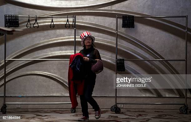 A woman leaves an event organised by the US consulate in Shanghai to follow the results of the final day of the US presidential election on November...