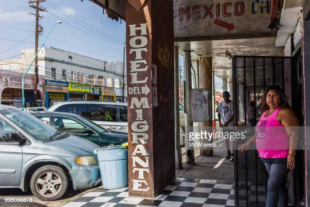 MEXICALI MEXICO July 10 A woman leaves Hotel del Migrante on July 10 2018 in Mexicali Mexico Hotel del Migrante is a place that offers housing and...