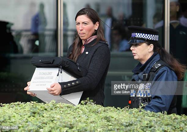 Woman leaves Lehman Brothers' Canary Wharf office carrying belongings on September 15, 2008 in London, England. The fourth largest American...
