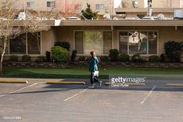 A woman leaves Life Care Center of Kirkland on February 29 2020 in Kirkland Washington Dozens of staff and residents at Life Care Center of Kirkland...