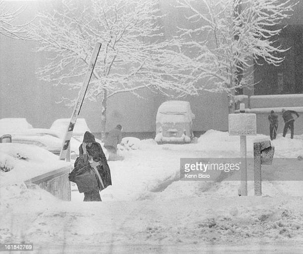 NOV 20 1979 NOV 21 1979 Woman Leaves parking lot through toll gate but her car isn't to lucky Men in background attempt to dig their own cars out...