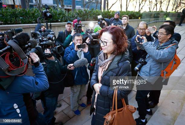 A woman leaves the BC Supreme Courthouse after observing the bail hearing for Huawei Technologies Chief Financial Officer Meng Wanzhou in Vancouver...