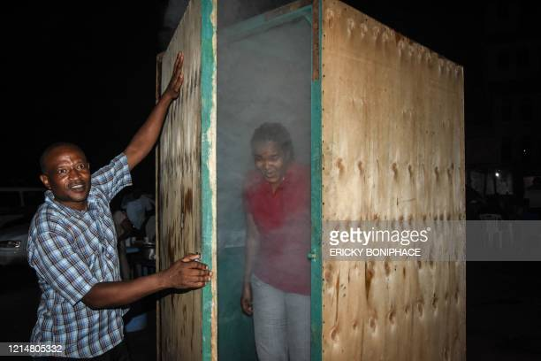 TOPSHOT A woman leaves the steam inhalation booth installed by Tanzanian herbalist Msafiri Mjema in Dar es Salaam Tanzania on May 22 2020 after using...