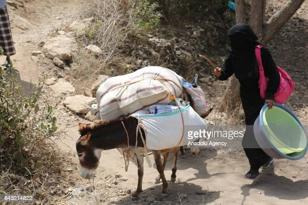Woman leaves the village with his belongings after Houthis captured Tubeysia village in Taiz province, Yemen on February 20, 2017.
