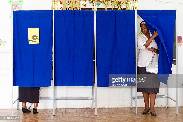 A woman leaves the voting booth in the polling station of Cayenne on the French South American territory of Guiana on January 10 for the referendum...