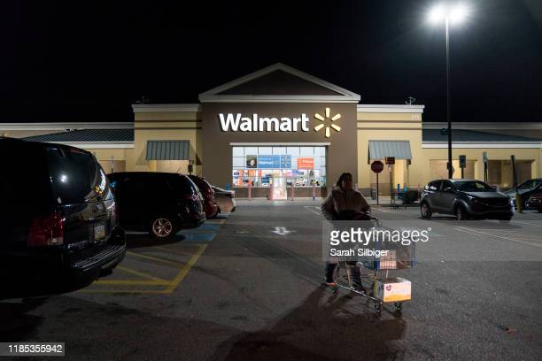 Woman leaves Walmart on Thanksgiving night ahead of Black Friday on November 28, 2019 in King of Prussia, United States.