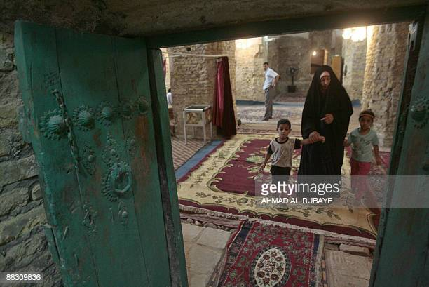 KRAUSS A woman leaves with her children after visiting the four tombs belonging to the four Jewish companions of the Jewish prophet Ezekiel the...