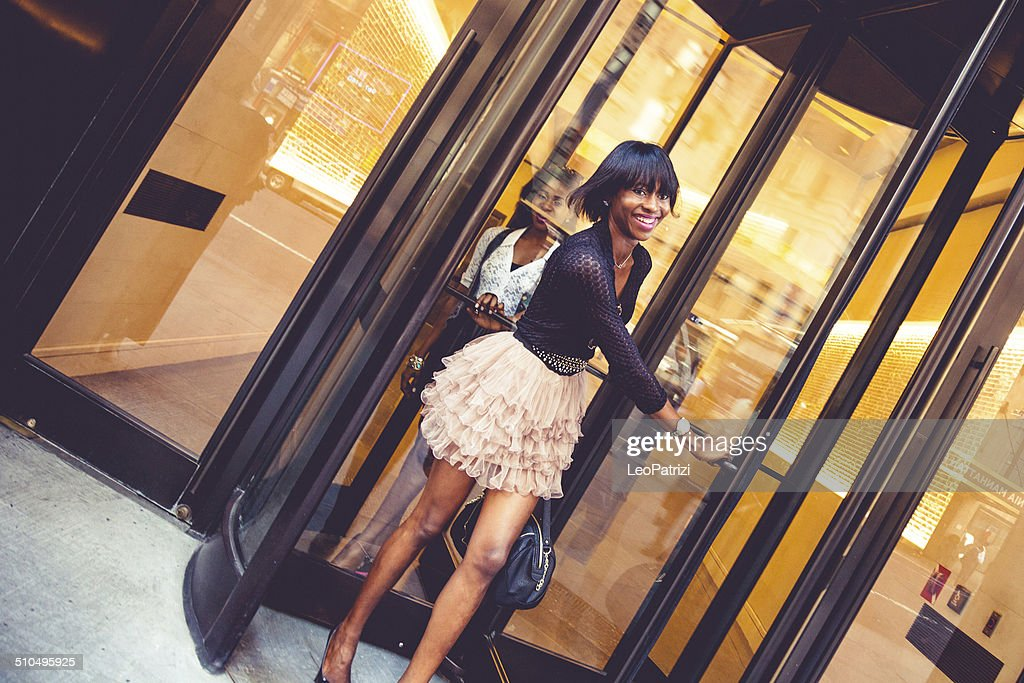 Woman leaving the hotel : Stock Photo