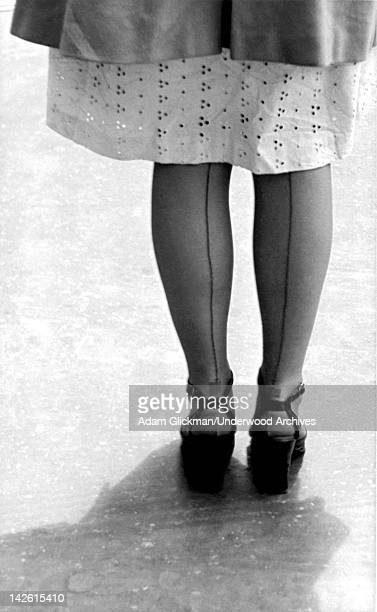 A woman legs from the back showing the seams in her stockings late 1940s or early 1950s