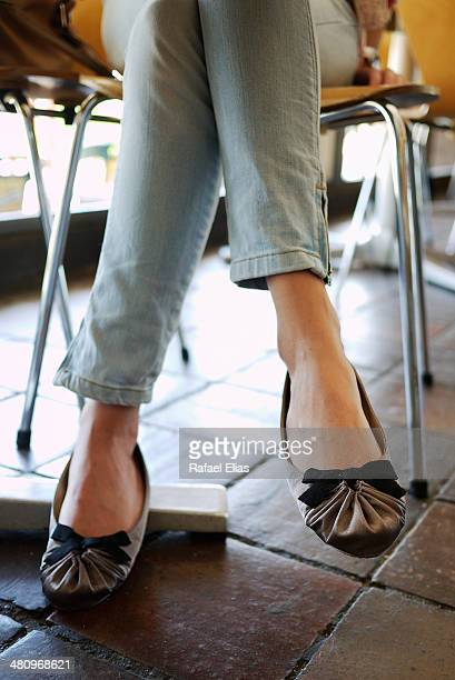 woman legs in bar - flat shoe stock pictures, royalty-free photos & images