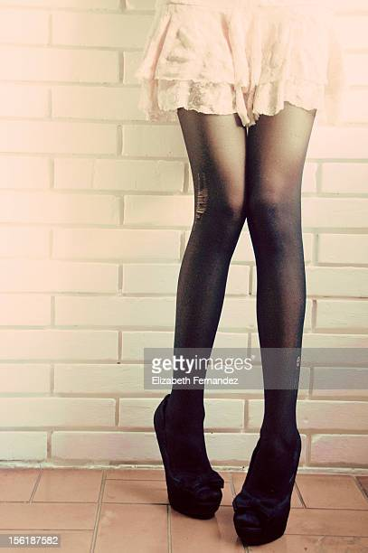 woman legs in miniskirts and pumps - short skirts and stockings stock photos and pictures