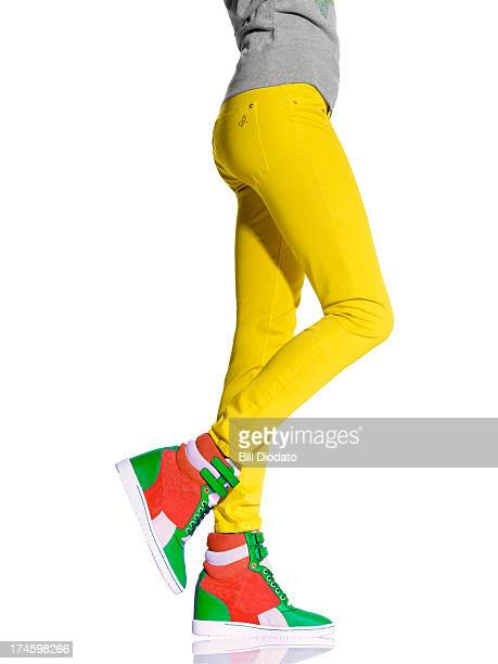 woman legs in wedge sneakers - yellow trousers stock pictures, royalty-free photos & images