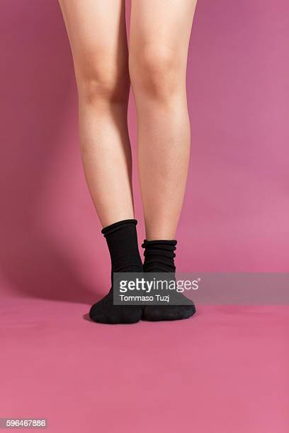 woman legs on pink background - pink sock image stock pictures, royalty-free photos & images