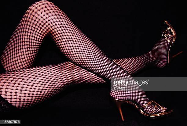 woman legs with heels and fishnets - fishnet stockings stock pictures, royalty-free photos & images